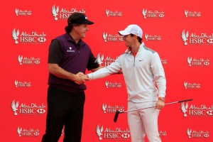 14-01-14 European Tour 2014, Abu Dhabi HSBC Golf Championship, Abu Dhabi Golf Club, Abu Dhabi, United Arab Emirates. 16-19 Jan. Phil  Mickelson of United States shake hands with Rory McIlroy at a photocall ahead of the Abu Dhabi HSBC Golf Championship.