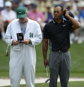 10-04-15 European Tour 2015, The Masters Tournament, Augusta National GC, Augusta, Georgia, USA. 09-12 Apr. Tiger  Woods of United States right, glances over at the yardage book his caddie, Joe LaCava, left, holds on the 16th green during the second round. # NO AGENTS #