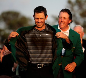 10-04-2011 European Tour 2011, The Masters Tournament, Augusta National, Augusta, Georgia, USA. 01-10 April Charl Schwartzel of South Africa Last years champion Phil Mickelson helps on this years champion Charl Schwartzel with his new green jacket after he wins the 2011 Masters Golf Tournament .