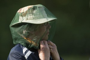02-06-2012 Ladies European Tour 2012, Deloitte Ladies Open, Golfclub Broekpolder, Rotterdam, The Netherlands. 01-03 June. A volunteer with a mosquito net during the second round.